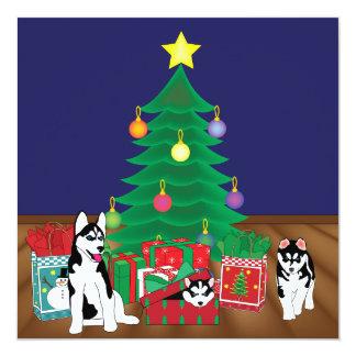 クリスマスツリーカードの下で遊ぶハスキー カード