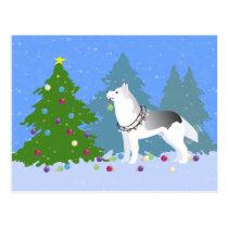 クリスマスツリー-森林--を飾っているシベリアンハスキー 葉書き
