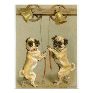 クリスマス鐘を鳴らしている2匹のパグ犬 レターヘッド