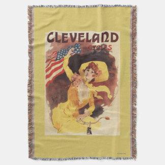 クリーブランドによっては黄色のアメリカの女の子が自転車に乗ります スローブランケット