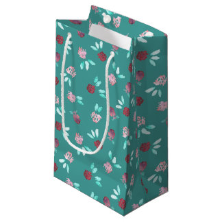 クローバーによっては小さい光沢のあるギフトバッグが開花します スモールペーパーバッグ
