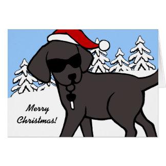 クールで黒いラブラドールの暗い漫画のクリスマスカード グリーティングカード