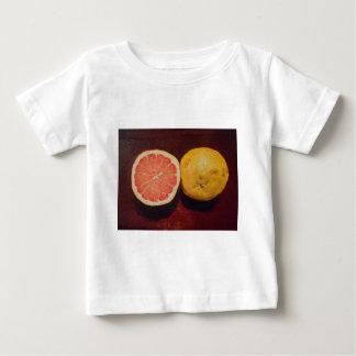 グレープフルーツのピンクのフルーツ ベビーTシャツ