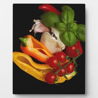 コショウのベズルのトマトのニンニク フォトプラーク