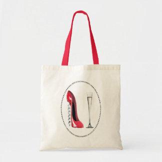 コルクせん抜きの赤い小剣およびシャンペンフルートのギフト トートバッグ