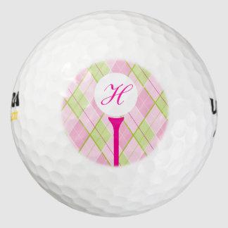ゴルフピンクの格子縞のモノグラムのイニシャルのゴルフ・ボール ゴルフボール