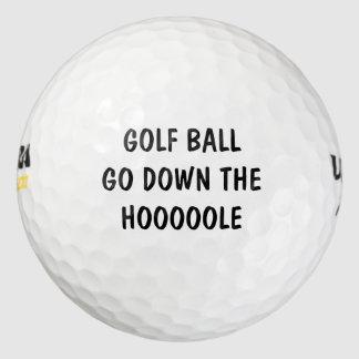 ゴルフ・ボールは穴のおもしろいなゴルフ・ボールをたどって行きます ゴルフボール