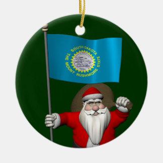 サウスダコタの旗を持つサンタクロース セラミックオーナメント