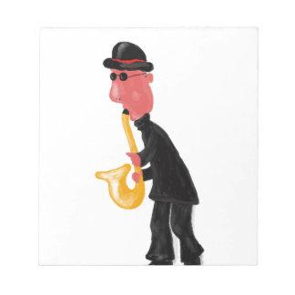 サクソフォーンを演奏している人 ノートパッド