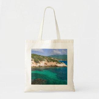 サルジニアからの海の眺めのバッグ トートバッグ