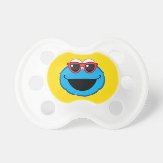 サングラスが付いているクッキーの微笑の顔 おしゃぶり
