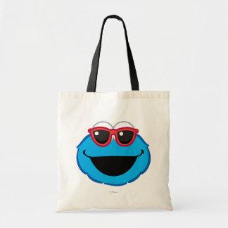 サングラスが付いているクッキーの微笑の顔 トートバッグ