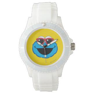 サングラスが付いているクッキーの微笑の顔 腕時計