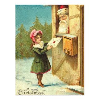 サンタに彼女の手紙を郵送しているビクトリアンな女の子 ポストカード
