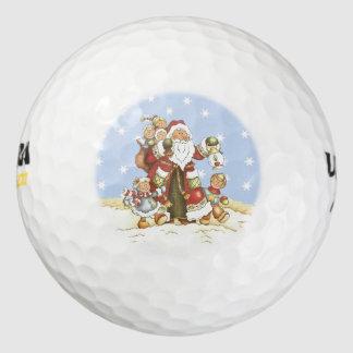 サンタのかわいい民芸はクリスマスの雪片をからかいます ゴルフボール