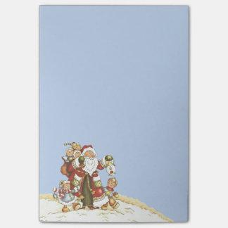 サンタのかわいい民芸はクリスマスの雪片をからかいます ポストイット