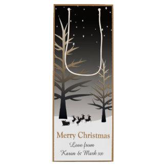 サンタのそりおよび木のシルエット ワインギフトバッグ