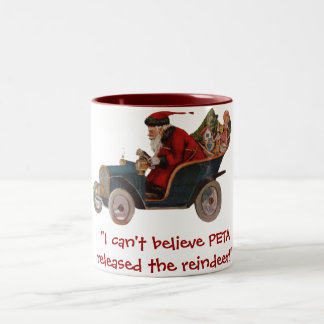 サンタのぽんこつ車PETAのトナカイのマグ ツートーンマグカップ