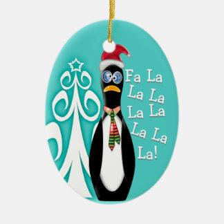 サンタのペンギンは完全に買物をしました(名前入り) 陶器製卵型オーナメント