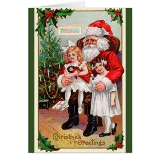 サンタのラップのホリデーカードに坐っている子供 カード