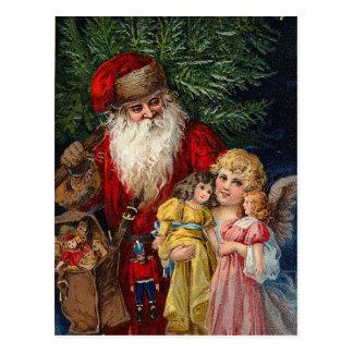 サンタの天使のビクトリアンな人形のクリスマス ポストカード