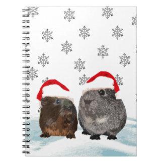 サンタの帽子のかわいいクリスマスのモルモット ノートブック