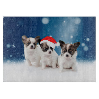 サンタの帽子のクリスマスのかわいいチワワの子犬 カッティングボード
