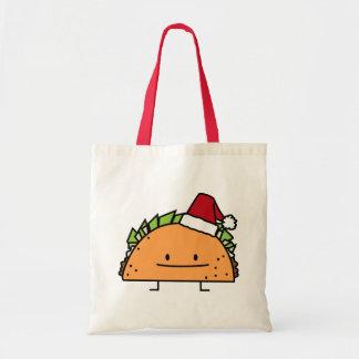 サンタの帽子のクリスマスの貝肉サルサを身に着けているタコス トートバッグ