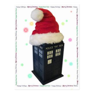 サンタの帽子のクリスマスの青い警察箱 ポストカード