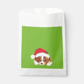 サンタの帽子の好意のバッグを持つ赤い三クリスマスの子犬 フェイバーバッグ