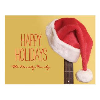サンタの帽子は前部のアコースティックギターでつるします ポストカード