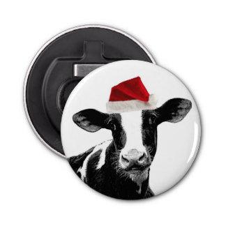 サンタの帽子を持つかわいい休日の乳牛 栓抜き