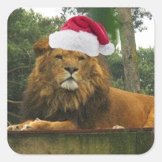 サンタの帽子を身に着けているクリスマスのライオン スクエアシール