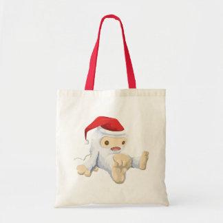 サンタの帽子を身に着けているクリスマスの雪男の人形 トートバッグ