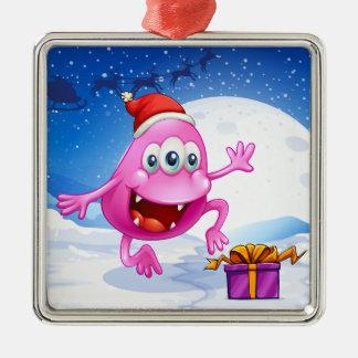 サンタの帽子を身に着けている幸せなピンクの帽子モンスター メタルオーナメント