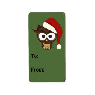 サンタの帽子を身に着けている怒っているフクロウ ラベル