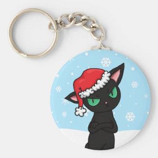 サンタの帽子を身に着けている気難しい黒猫 キーホルダー