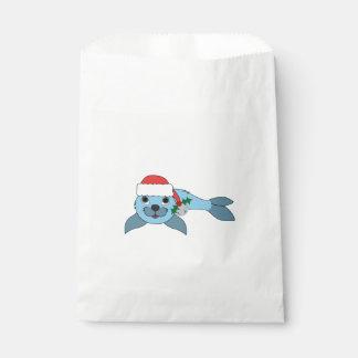 サンタの帽子及びシルバーベルが付いている淡いブルーの子どものアシカ フェイバーバッグ