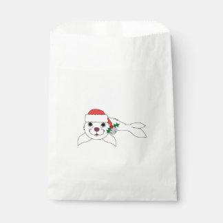 サンタの帽子及びシルバーベルが付いている白い子どものアシカ フェイバーバッグ