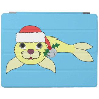 サンタの帽子及びシルバーベルが付いている黄色い子どものアシカ iPadスマートカバー