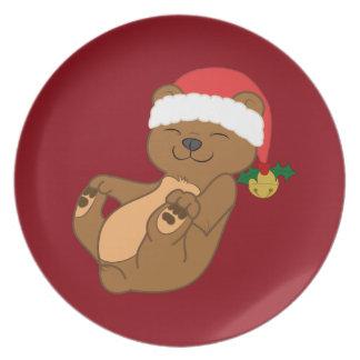 サンタの帽子及びジングルベルを持つクリスマスのヒグマ プレート