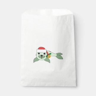 サンタの帽子及び金ゴールド鐘の薄緑の子どものアシカ フェイバーバッグ