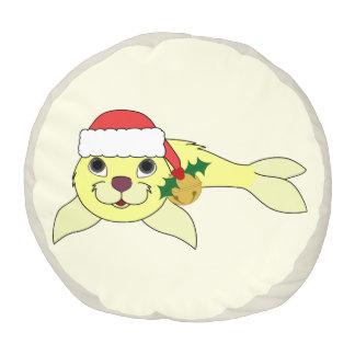 サンタの帽子及び金ゴールド鐘の黄色い子どものアシカ プーフ