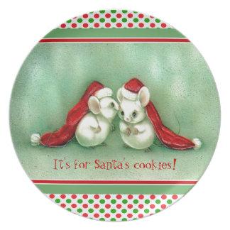 サンタの赤い帽子が付いているヴィンテージのクリスマスのネズミ プレート