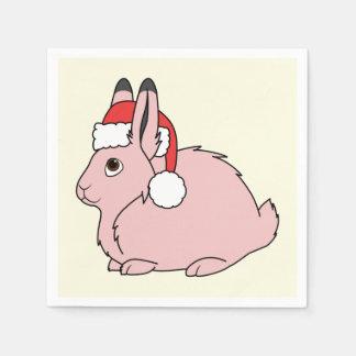 サンタの赤い帽子が付いている淡いピンクの北極ノウサギ スタンダードカクテルナプキン