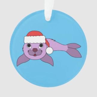 サンタの赤い帽子が付いている薄紫の子どものアシカ オーナメント