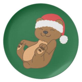 サンタの赤い帽子を持つクリスマスのヒグマ プレート
