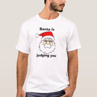 サンタは判断しています Tシャツ