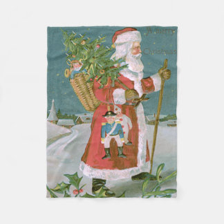サンタクロースのクリスマスツリーのバスケットはヒイラギをもてあそびます フリースブランケット