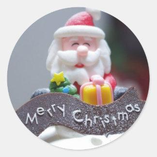 サンタクロースのケーキのクリスマス・パーティ ラウンドシール